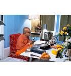Srila Prabhupada Sitting at his Desk Translating Srimad-Bhagavatam