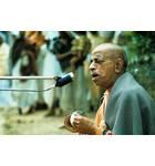 Srila Prabhupada Leads Kirtan Outside Sitting on Grass