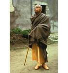 Srila Prabhupada in a very Stately Pose Outside Old Building